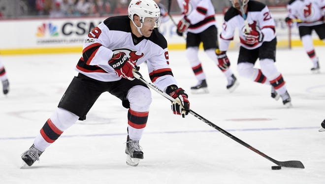 New Jersey Devils left wing Taylor Hall (9) skates with the puck during the second period of an NHL hockey game against the Washington Capitals, Thursday, March 2, 2017, in Washington. (AP Photo/Nick Wass)