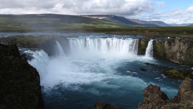 Hundreds of waterfalls like this one can be seen all over Iceland.