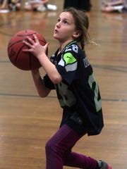 7-year-old Alexandra Donoghue of Chatham shoots a free throw as the Madison Area YMCA hosts the NBA FiT Dribble, Dish & Swish for youngsters.
