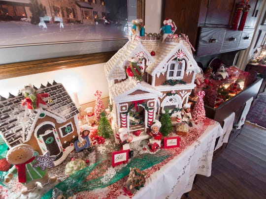 Gingerbread houses are in the kitchen of the Carter home.