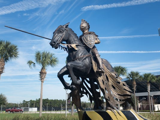 635650495819563030-UCF-Buildings-Jousting-knight-statue-Bright-House-Stadium