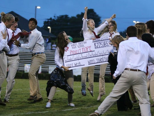Wade Hampton High students celebrate after revealing