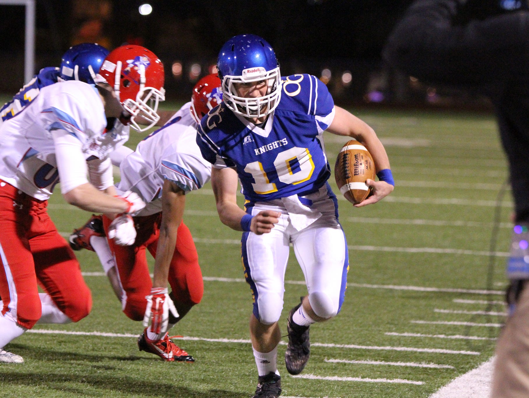 Luke Fritsch of O'Gorman is forced out of bounds by several Lincoln defenders during Thursday night's game at O'Gorman.