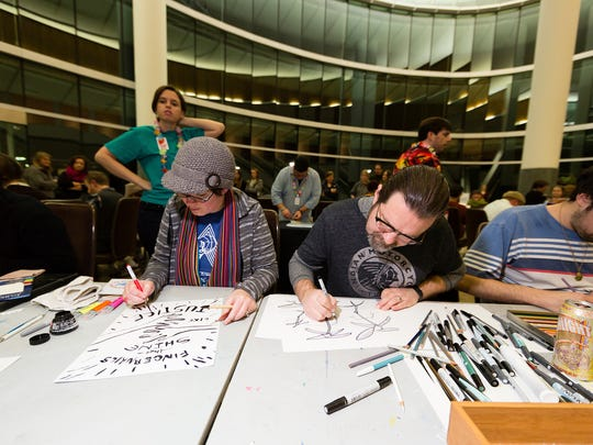 Local artists complete drawings as fast as they can during last year's Monster Drawing Rally. This year's event will feature more than 100 artists.