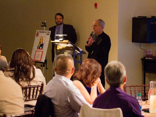 Bishop Mark J. Seitz speaks to educators.