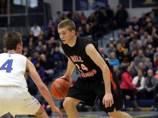 Ty Hoglund of Dell Rapids attempts to get around SF Christian's Lincoln Unruh during Tuesday's Region 3A game at the Elmen Center.