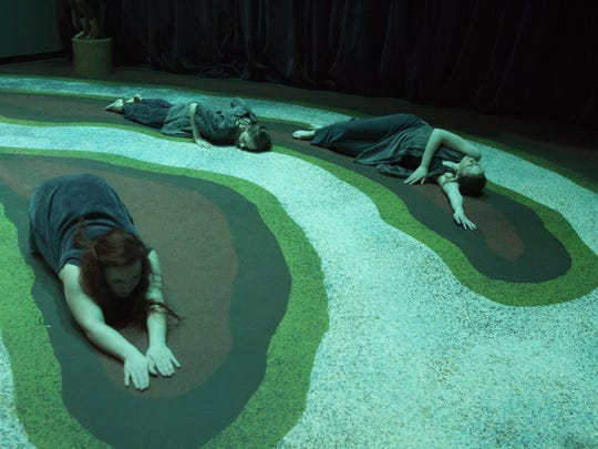 "Luther College dancers occupied river-delta islands painted on a theater floor for ""Body of Water,"" which premiered in 2015 in Decorah."