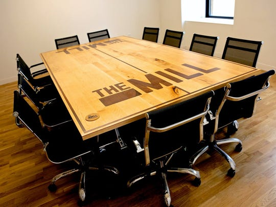 A conference room table is seen in The Mill, a coworking space in Wilmington's Nemours Building. The table was built by students in the Challenge Program and doubles as a ping-pong table.