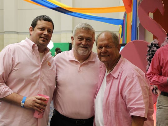 Rex Dirks, Jody Booth, Mike Harelson at the Pink Party.