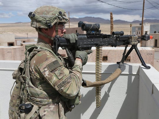 Soldiers from Alpha Company, 4th Battalion, 6th Infantry Regiment set up security for a noncombatant evacuation exercise during the rotation at the National Training Center, Fort Irwin, Calif.
