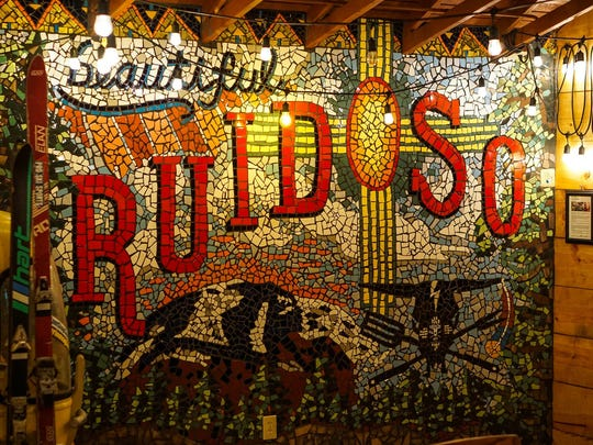Summer Sarinova brings to life old time Ruidoso with a huge piece of mosaic art work at Can't Stop Smoking BBQ, 418 Mechem Drive, and Smokehouse's new dining room.