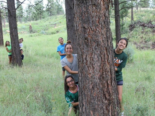 The RHS girls cross country team plays a bit of hide-and-seek.