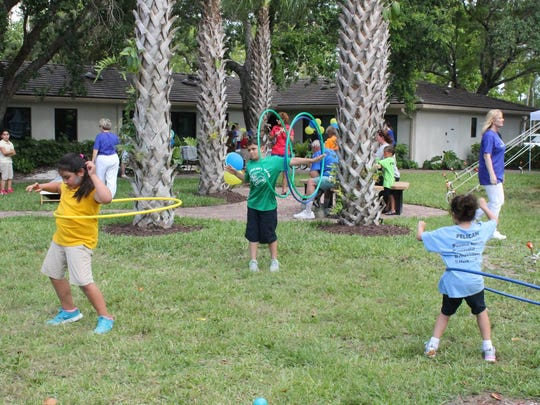 Children enjoy hula hoops during Mental Health Awareness Month Fair and Open House at the David Lawrence Center earlier this year.