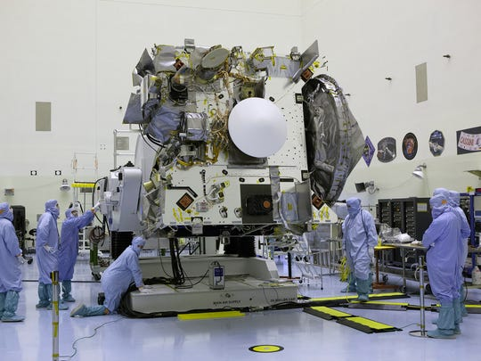 At Kennedy Space Center in June, technicians and engineers inspected the OSIRIS-REx spacecraft targeting a Sept. 8 liftoff aboard a United Launch Alliance Atlas V rocket.