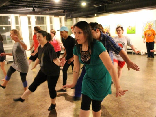 Cast members from 'Young Frankenstein' practice. The cast will perform at Wine Around the Square Saturday.