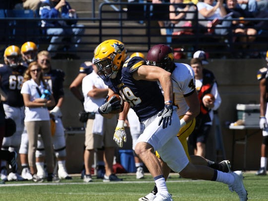 Matt Heller of Augustana sprints to the end-zone for