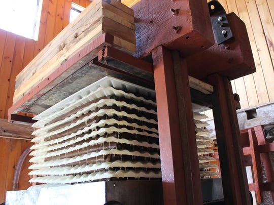 Stacked racks filled with ground apple in the antique