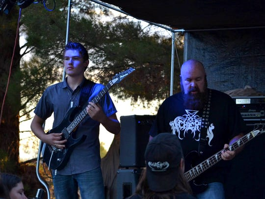 Keith Clute and Michael Gonzalez of 4130, a local heavy metal band, play on Saturday.