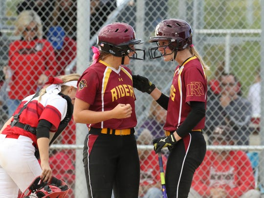 Roosevelt's Macy Schroedermeier (L) celebrates with Abby Schultz after scoring a run in the State Championship game against Brandon Valley at Sherman Park.