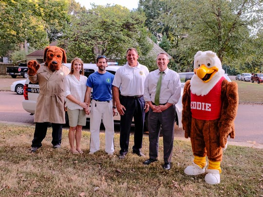 McGruff the Crime Fighter Dog, from left, Emily and Drew Cutliff (the host family of the English Meadows Night Out) Germantown Police Chief Richard L. Hall, Mayor Mike Palazzolo, and Eddie the Eagle attended Germantown's Night Out.