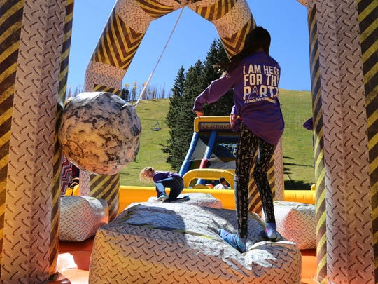Ski Apache's inflatable obstacle course presents some challenges to participants.