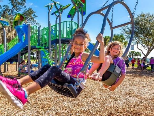 636126484977616418-Univ-Park-students-at-Riverivew-Park-playground-2.jpg