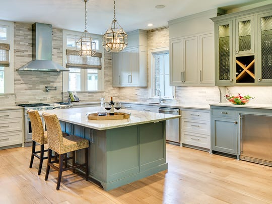 The kitchen at 1126 Waters Edge features shaker-style