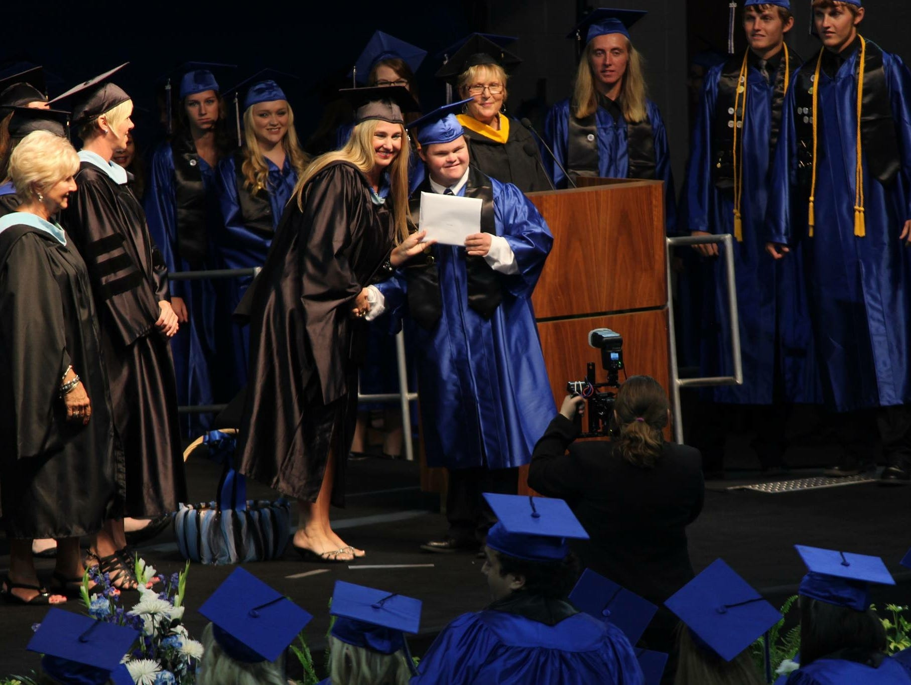 Ida Baker student Christian Diggs, right, holds up his diploma alongside his mother, Debbie, an assistant principal with the Bulldogs in 2016.
