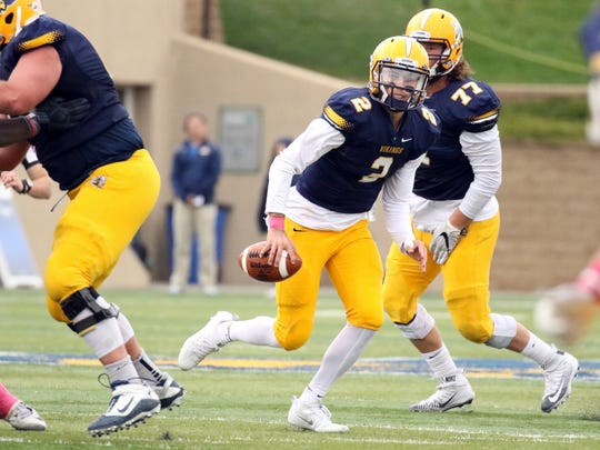 Trey Heid of Augustana scrambles from the pocket during