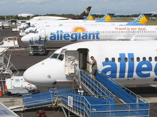 Passenger aircraft with Allegiant Air's fleet are parked on the tarmac at St. Pete-Clearwater International Airport on Wednesday (4/15/15).