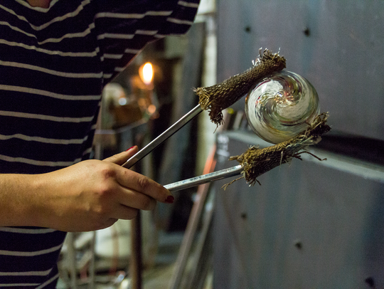 Visit the N.C. Glass Center in the River Arts District to learn about blowing glass.