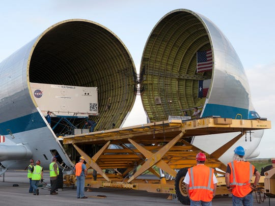 On Aug. 26, 2016, technicians have positioned a platform close to NASA's Super Guppy aircraft at the Shuttle Landing Facility, managed and operated by Space Florida, at Kennedy Space Center for offloading of the shipping container carrying the Orion heat shield for Exploration Mission 1.