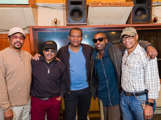 Bluesman Robert Cray (center) and drummer/producer Steve Jordan (second from right) have been recording at Royal Studios with Hi Rhythm members Leroy Hodges (from left), Archie Turner and Charles Hodges.