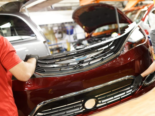 Production of the industry's first hybrid minivan began on Thursday at Fiat Chrysler Automobiles' Windsor Assembly Plant.