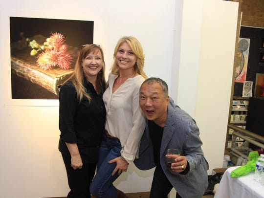 Molly Wood, Amy Allen and King Au at an art gallery opening for Wood in October 2016.