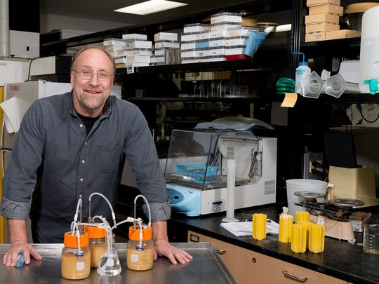 James Steele, food science professor at UW-Madison, is shown with homemade fermenters that he's using to explore genetic engineering of lactic acid bacteria, a common contaminant of many fermentation processes, including cheese, wine, beer and biofuel production.