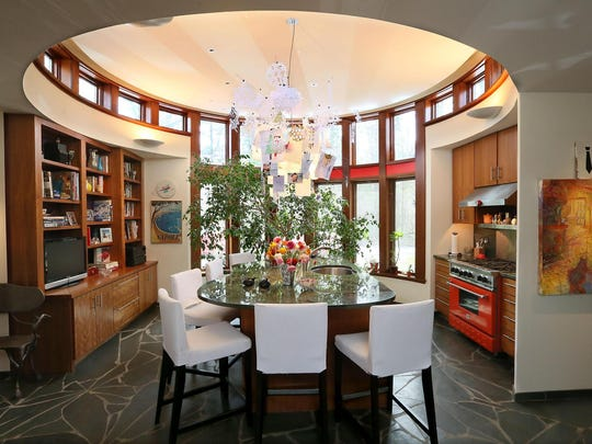 The kitchen in the Fox Point home of Steven and Jane Klein is round, with an amoeba-shaped island.
