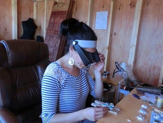 Rebecca McWilliams designing jewelry.