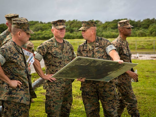 In this January 2017 file photo, U.S. Marine Corps Lt. Gen. Lawrence Nicholson Berger, center, commanding general, III Marine Expeditionary Force and commander, Marine Forces Japan, speaks in Dededo with Col. Brent Bien, officer-in-charge of Marine Corps Activity Guam, Lt. Col. Marcus Reynolds, executive officer of Marine Corps Activity Guam and Craig Weldon, executive director of Marine Corps Pacific, to show the future layout of Marine Corps Base Guam.