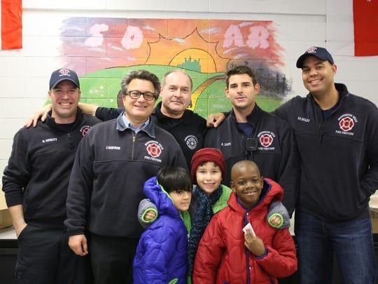Farmington HIlls firefighters Bryan Hewitt, John Kastran,