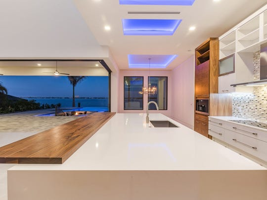The kitchen island is made of the largest single piece of granite that can be manufactured.