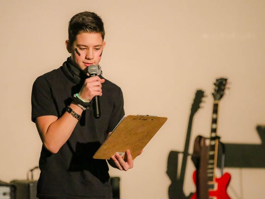 Reed Marple, a member of Grace Fellowship Youth, makes announcements during the event.