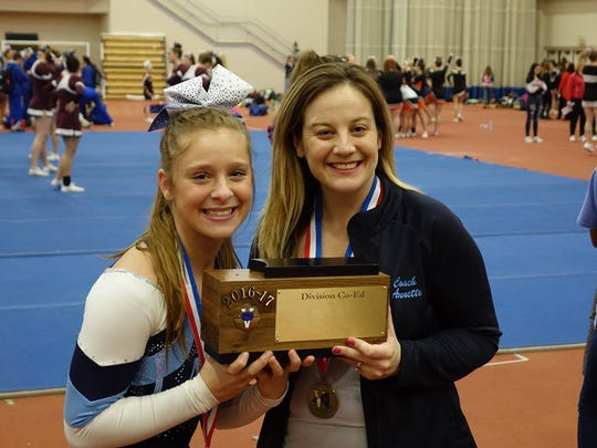 Shannon Coffaro and coach Annette Fess hold a trophy earned during the Section V Championships.