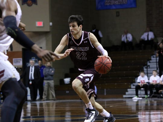 Adam Eberhard of Bellarmine brings the ball upcourt against Fairmont State during Thursday's semifinal game in Sioux Falls.