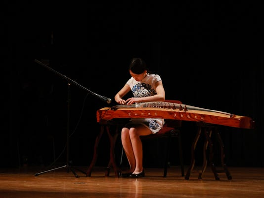 636262301521616035-Wenxin-Song-playing-the-guzheng-captured-by-Anna-Wiman-Rickards-student-photographer.jpg