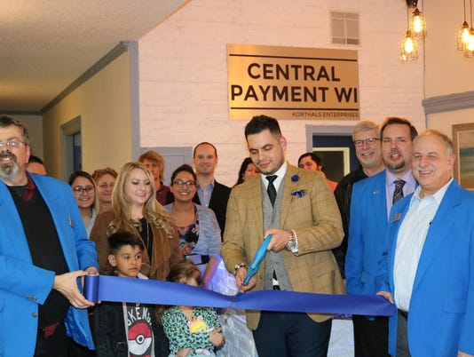 Central Payment ribbon-cutting