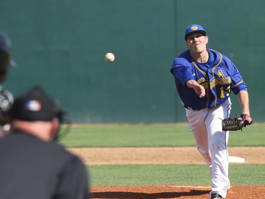 Grady Wood of the Canaries delivers a pitch during