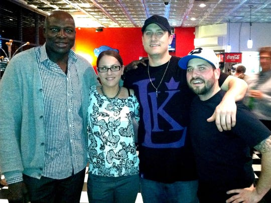 Bruce Smith first visited the The Dirty Buffalo in 2012. Smith poses with owners Stephanie and Russ Gilbert (center) and general manager Ryan Lynn.