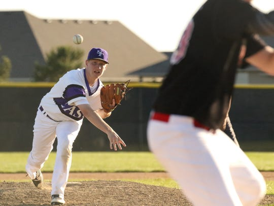 Brandon Ford of Post 15 East delivers a pitch during