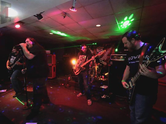The Lafayette rock band Vermilion Whiskey jams during